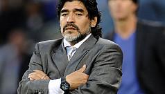 Maradona stands beside Argentina
