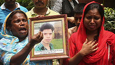 Holey victim's family initially faces...