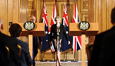 Weakened British PM May reaches out...