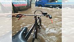 Rain cripples life in Dhaka