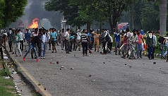 Clashes kill 32 in India as court convicts...