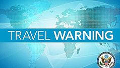 US partially relaxes travel warning...