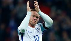 Rooney retires from international...