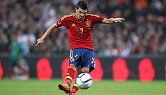 Villa makes surprise return to Spain...
