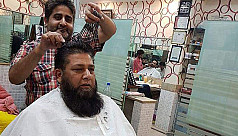 Pakistani barber and his 15 pairs of...