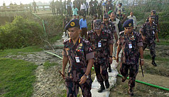 Myanmar reinforces barbed wire fence...