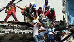 Mexico rescuers work into night to save...