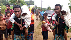 Rohingya man carries mother for...