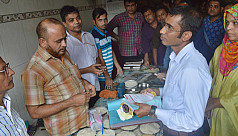 Trader jailed for hoarding rice in...