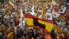 Spain pressures Catalans after threats...