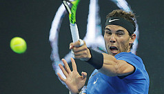 Nadal defies tennis ball hair mishap...