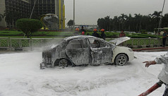 Private car catches fire at Dhaka...
