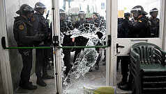 Spanish police storm polling station...
