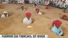 Indian farmers stay neck-deep in ground...