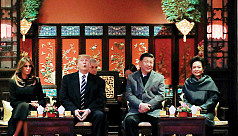 China's Xi fetes Trump on first day...