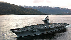 Three US naval carriers lead military...