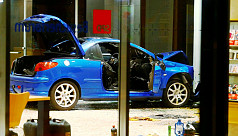 Man rams car into German party HQ in...