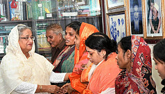 PM hands over compensations to families...