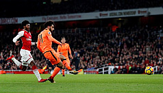 Arsenal and Liverpool share spoils in...