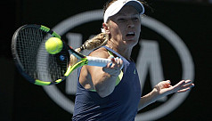 Wozniacki survives scare to reach maiden...