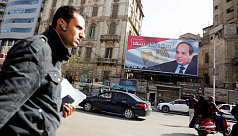 Amid slow voting, Egypt's Sisi cruises...