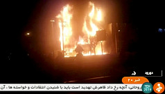 Iranian protesters attack police stations,...