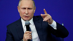 Putin jokes he's 'offended' not to be...