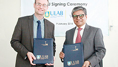ULAB, Washburn University sign instrument...