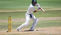 Kohli century keeps India in touch with...
