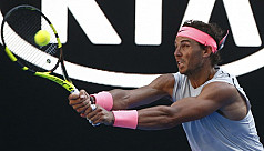 Nadal mows down Mayer to reach third...