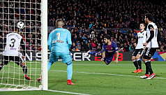 Suarez puts Barca on course for another...