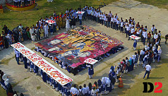 Students exhibit human mural in tribute...