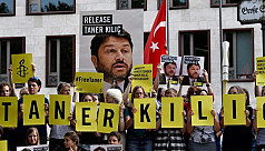 Turkey detains Amnesty chief after court...