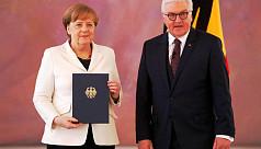 Merkel narrowly elected to fourth term...