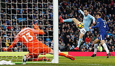 Man City march on as Chelsea woes...
