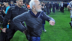 Club owner invades pitch carrying firearm...