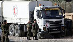 Aid reaches Syria's Ghouta as strikes...