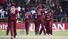 Rain helps West Indies edge out Scotland...