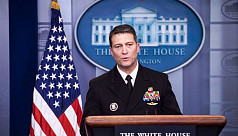 White House doctor withdraws bid for...