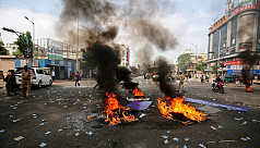 Mob burns homes in fresh India caste...
