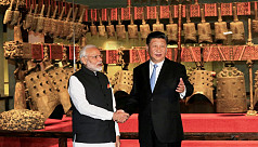 Xi meets Modi, eyes 'new chapter' in...