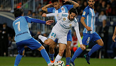 Isco leads Real win at Malaga, Atletico...
