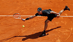 Thiem saves match point in victory over...