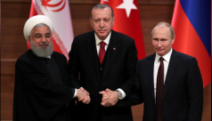 Turkish, Iranian leaders meet ahead...