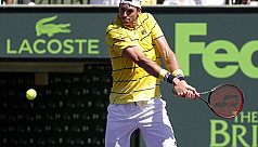 Isner upsets Zverev to win Miami...