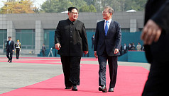 Smiles and handshakes open Korea summit,...