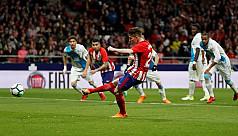 Atletico edges past Deportivo, closer...