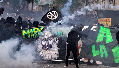 Riot police, masked protesters clash at Paris May Day rally