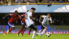 Messi grabs hat-trick as Argentina canter...