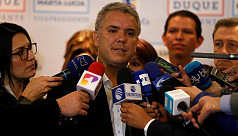 Right-winger Duque keeps lead in poll...